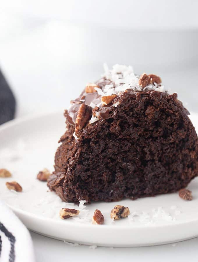 Triple Chocolate Bundt Cake - Try this triple chocolate bundt cake and you'll never bake plain ol' chocolate cake again. Rich, chocolaty, moist, and super easy. #halfscratched #bundt #bundtcake #chocolate #chocolatecake #baking #easydessert #easyrecipe #cake #cakerecipe