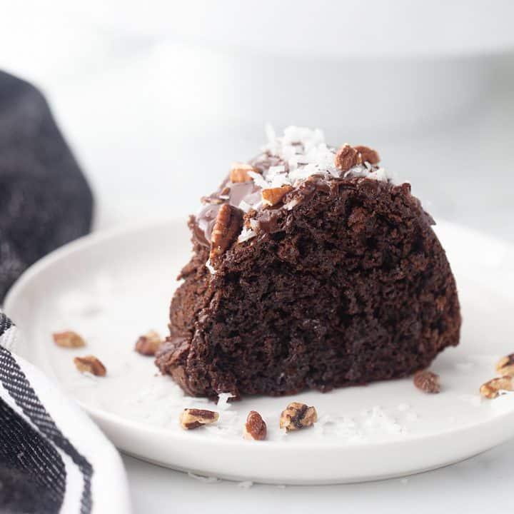 Triple Chocolate Bundt Cake - Try this triple chocolate bundt cake and you'll never bake plain ol' chocolate cake again. Rich, chocolaty, moist, and super easy. #halfscratched #bundt #bundtcake #chocolate #chocolatecake #baking #easydessert #easyrecipe #cake #cakerecipe