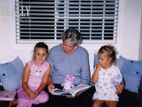Grandma reading book to grandkids