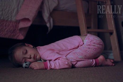 child asleep on floor
