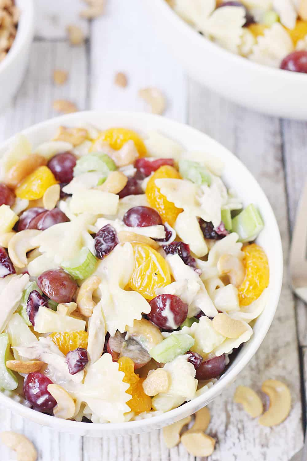 Chicken Bow Tie Pasta Salad -- Chicken bow tie pasta salad is the perfect summer salad! It combines so many delicious ingredients with the crunch of cashews and creamy coleslaw dressing.