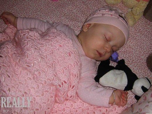 sleeping baby with Ty Beanie Baby panda
