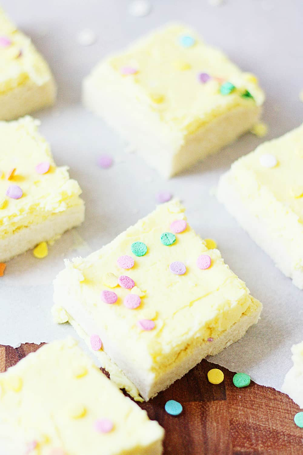 Sugar Cookie Bars - Sugar cookie bars are great for serving a crowd. They're soft and chewy and the frosting is to die for! Plus, they're quicker to make than their individually-portioned sugar cookie counterparts. | halfscratched.com