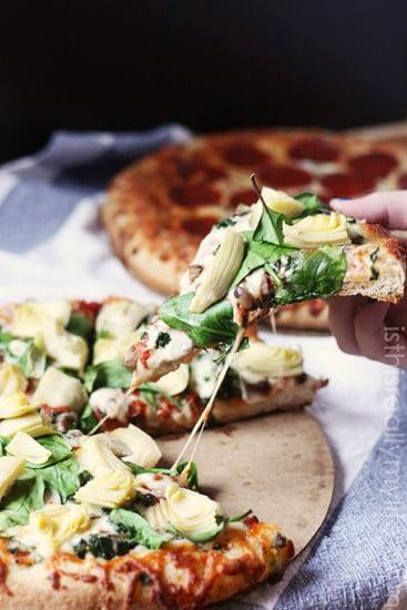 DiGiorno pizza with fresh spinach and artichoke hearts