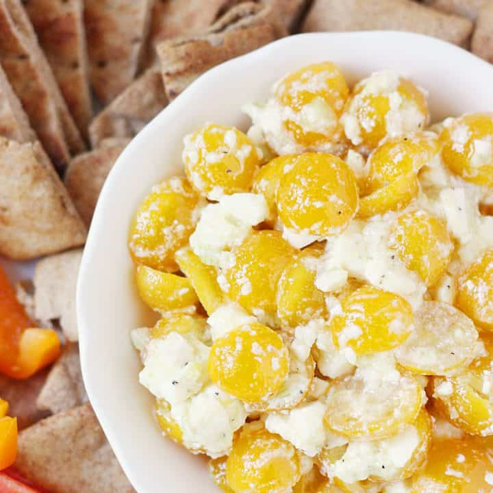 Greek Feta Dip -- Greek feta dip is so easy and addictive you'll want to make it every day. Trust me. The combo of golden tomatoes, feta, and seasonings is irresistible!