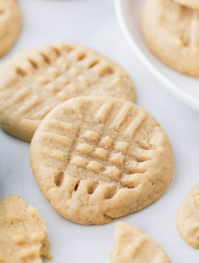 Old-Fashioned Peanut Butter Cookies - Old-fashioned peanut butter cookies are soft, chewy, and oh, so good! Friends and family (and my taste buds) always rave when I bake a batch. #halfscratched #peanutbutter #cookies #cookierecipe #baking #peanutbuttercookies #desserts #sweets #cookies