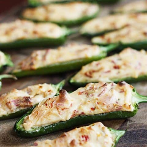 Vegetarian Stuffed Jalapenos with Sun-Dried Tomatoes & Bacon -- These vegetarian stuffed jalapenos with sun-dried tomatoes and bacon are simple, super tasty and a real crowd pleaser. Not vegetarian? Use real bacon instead!   halfscratched.com