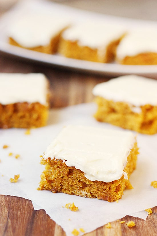 Pumpkin Bars with Orange Butter Frosting -- These pumpkin bars with orange butter frosting are so dang good you'll want to eat them year round. And you totally should.