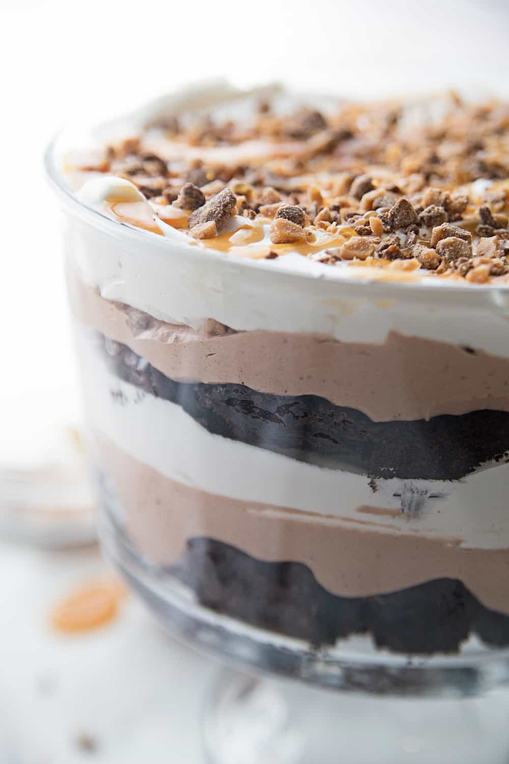 Chocolate Brownie Trifle - Chocolate brownie trifle features layers of rich, chocolate brownies, fudge pudding, whipped topping, toffee, and caramel. What's not to love? #trifle #brownie #dessert #halfscratched #chocolatetrifle #brownietrifle #sweet #baking