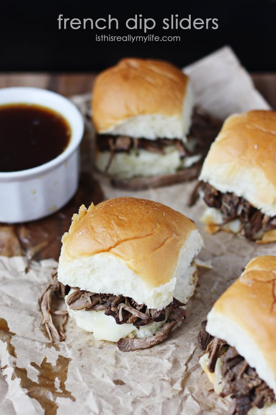 French Dip Sliders - so easy to make using a slow cooker and Hawaiian rolls. So fun to eat thanks to the smaller size!