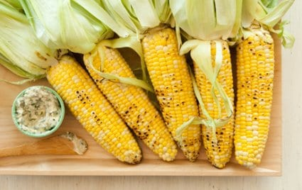 Corn on the cob with feta and herbs