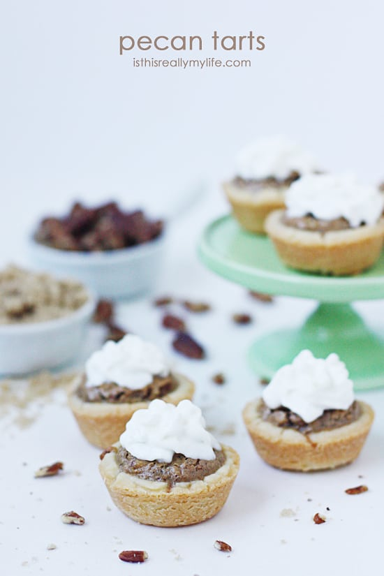 Pecan Tarts -- mini tarts filled with a delicious pecan filling. Perfect bite-size dessert! Recipe via halfscratched.com