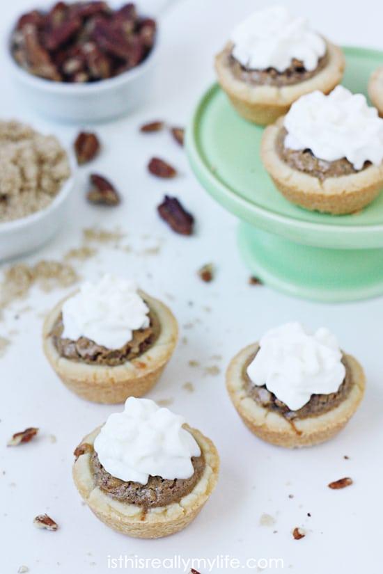 Pecan Tarts -- mini tarts filled with a delicious pecan filling. Perfect bite-size dessert! Recipe via halfscratched.com