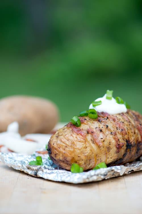 Bacon onion tin foil Hasselback potato