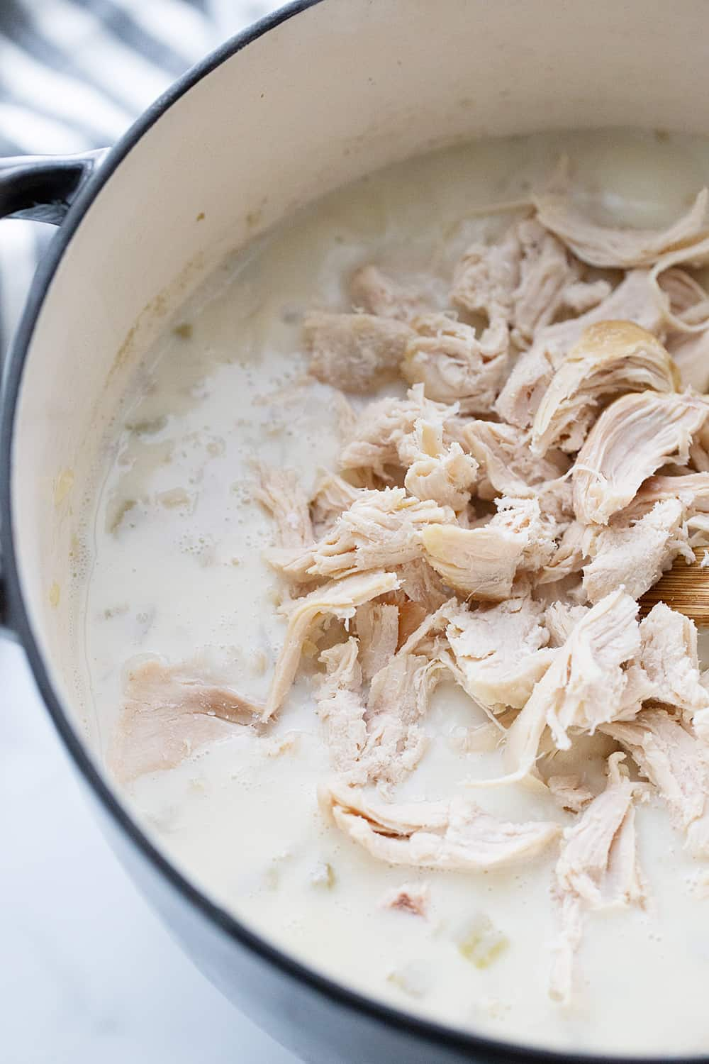 Creamy Chicken and Rice Soup - Creamy chicken and rice soup is a hearty meal with simple ingredients like brown rice, celery, onion, and chicken. Total family favorite! #halfscratched #soup #souprecipe #chickensoup #ricesoup #easyrecipe #maindish