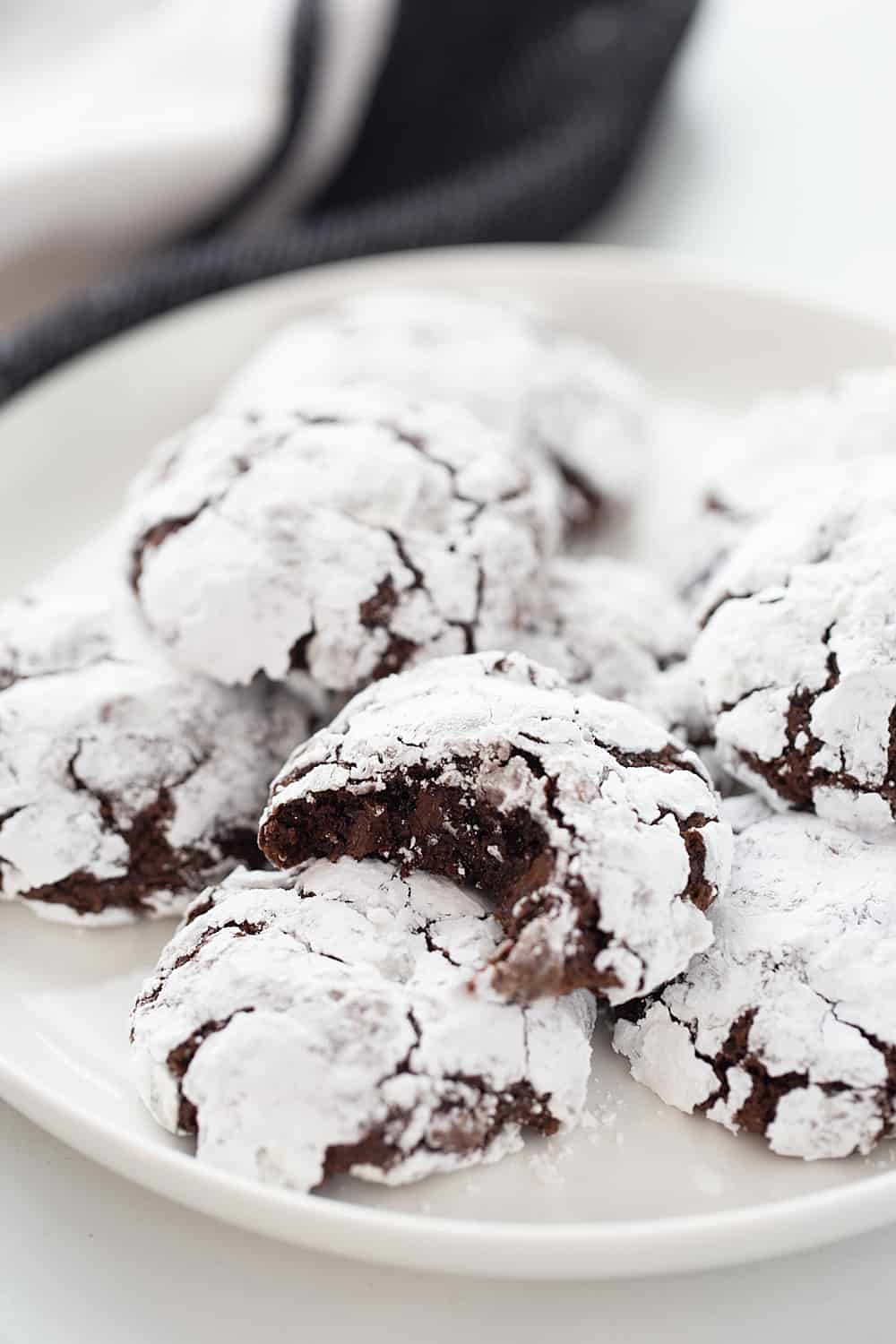 Double Chocolate Crinkle Cookies - Instant espresso powder + mini semisweet chocolate chips = next-level double chocolate crinkle cookies. One bite and you'll be hooked! #halfscratched #chocolate #cookies #crinklecookies #baking #cookierecipe #holidayrecipe #easyrecipe