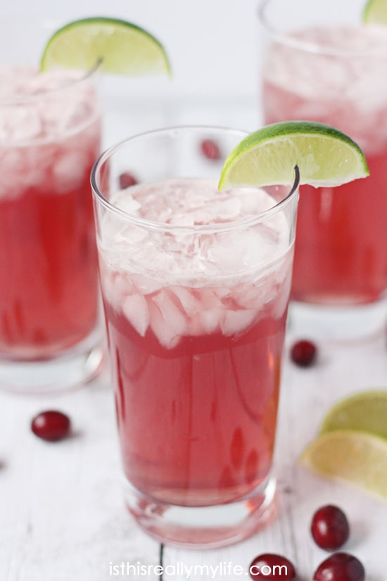 Very Berry Mocktail Recipe -- this non-alcoholic cocktail is full of berry flavor thanks to cranberry juice, pink lemonade and Dasani sparkling water in Berry flavor. Great for kids of all ages!