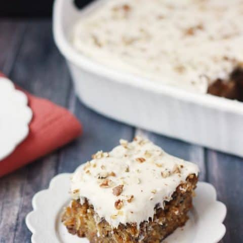 Buttemilk Glazed Carrot Cake with Cream Cheese Frosting -- my friend is famous for this cake and I can see why. The perfect carrot cake topped with a buttermilk glaze while hot and then topped with a divine cream cheese frosting. Best. Cake. Ever.