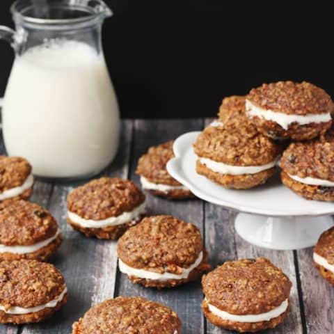 Carrot Cake Sandwich Cookies -- decadent, chewy carrot cake cookies with a creamy cream cheese filling. The perfect handheld dessert, especially during carrot cake season!