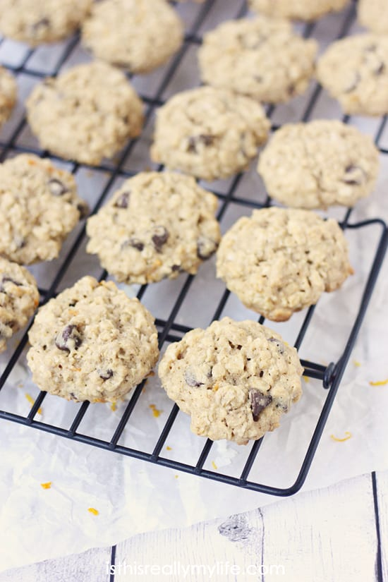 Healthy Orange Oatmeal Chocolate Chip Cookies -- whole wheat flour, unsweetened coconut, orange zest and semisweet chocolate. A dense, chewy cookie packed with flavor!