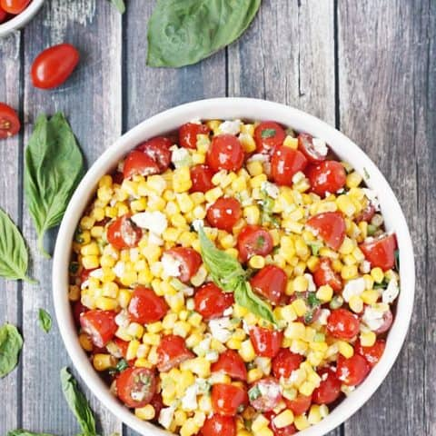 Corn salad with tomato, basil and feta -- the perfect way to highlight farm fresh corn in the summer!