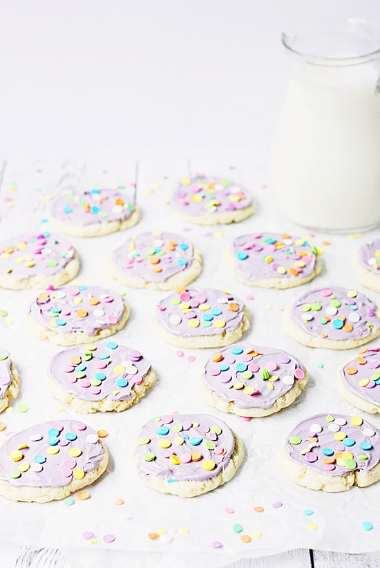 Sugar cookies with purple frosting and sprinkles