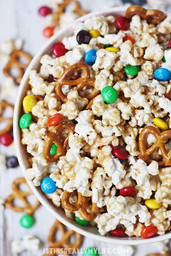 Healthy Peanut Butter Pretzel Popcorn -- Try this healthy peanut butter pretzel popcorn mix in place of those higher-fat, higher-sugar mixes out there. You will save on calories AND satisfy your sweet tooth!