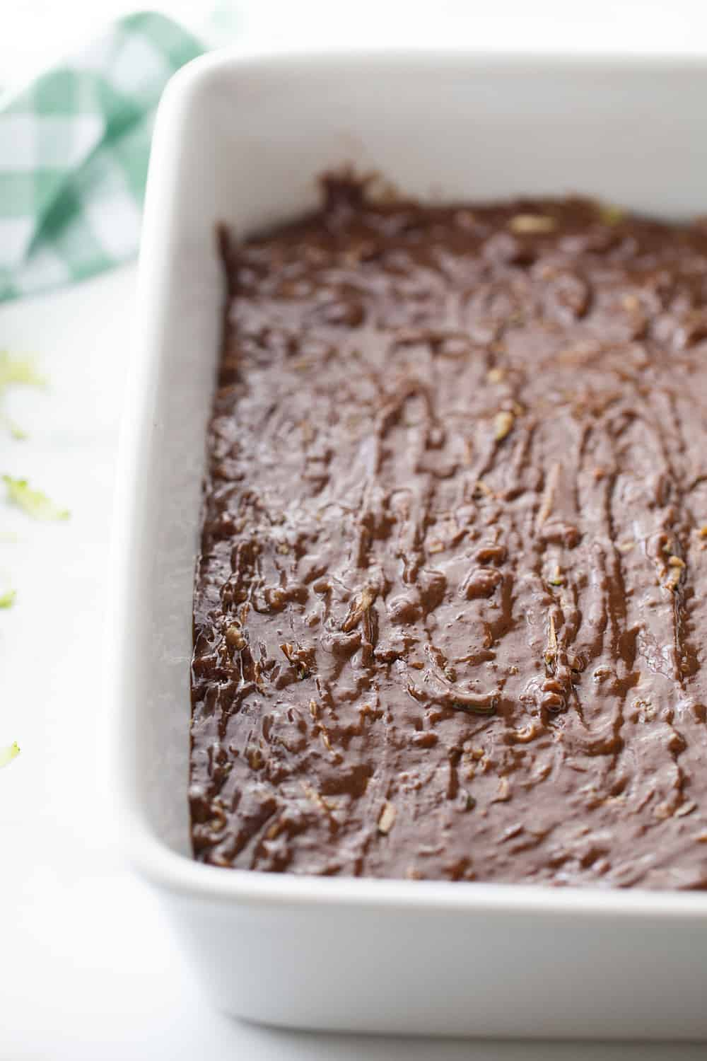 Frosted Zucchini Brownies - Frosted zucchini brownies feature a decadent chocolate flavor and rich, creamy frosting. And guess what? You can't taste zucchini in this brownie recipe! #halfscratched #brownies #brownie #recipe #baking #chocolate #zucchini #dessert #sweets