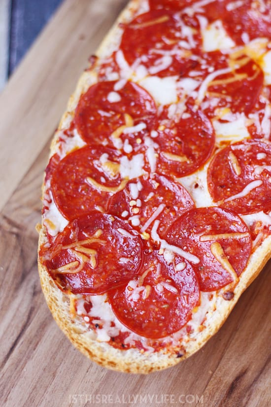 Easy French Bread Pizza - French bread pizza is a super quick and easy way to make homemade pizza. Let the kids make their own for a fun family meal!