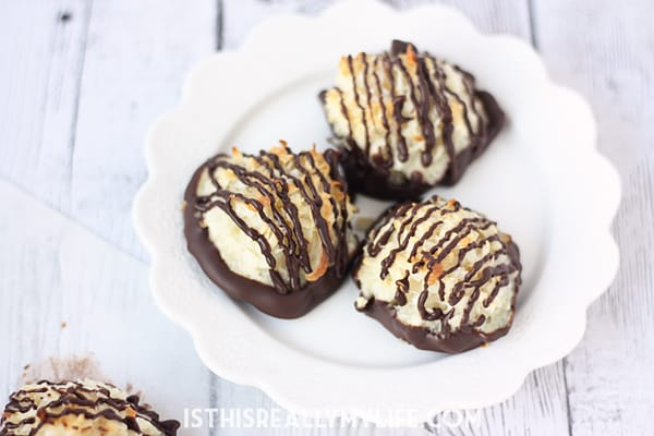 Easy Chocolate-Dipped Coconut Macaroons -- These coconut macaroons are slightly crunchy on the outside, perfectly chewy on the inside and easy to make. Dip them in dark chocolate for an irresistible treat! | halfscratched.com