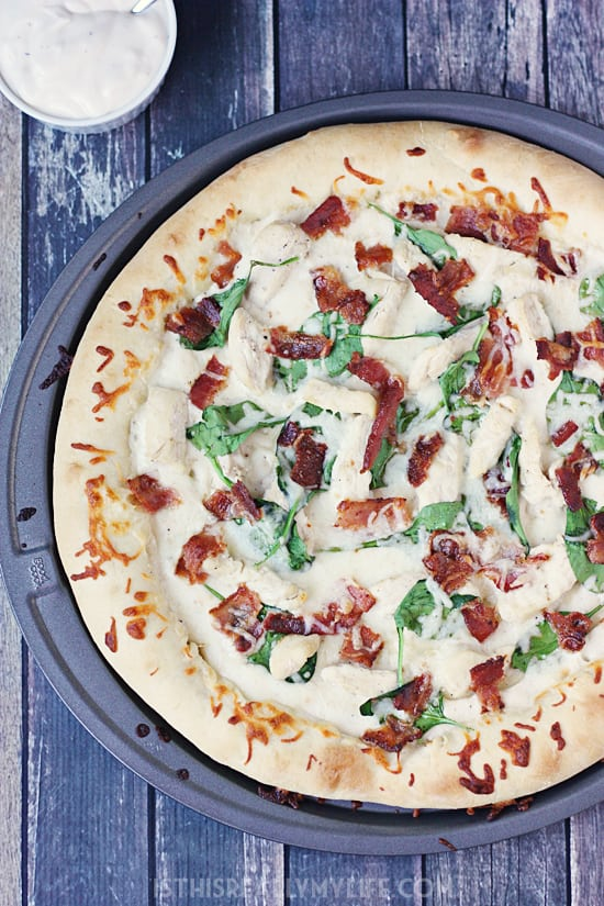 Stuffed crust chicken bacon spinach pizza with creamy alfredo - After tasting this homemade stuffed crust chicken bacon pizza with its super cheesy crust and creamy alfredo sauce, you will crave it all. the. time. | halfscratched.com