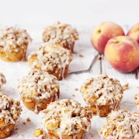 Peach Crisp Monkey Bread Muffins -- These peach crisp monkey bread muffins combine fresh, diced peaches, a delicious crumble topping and cinnamon roll dough for an easy, scrumptious treat! | halfscratched.com