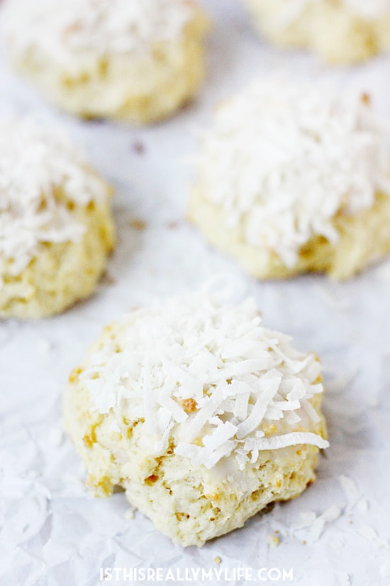Glazed Coconut Scones -- If you are a fan of coconut and enjoy a good scone, you will love these glazed coconut scones featuring shredded coconut inside and out! | halfscratched.com