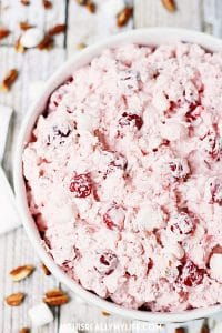 Cherry Pie Salad - Cherry pie salad requires six simple ingredients and less than six minutes to make and receives rave reviews whenever I serve it! | halfscratched.com
