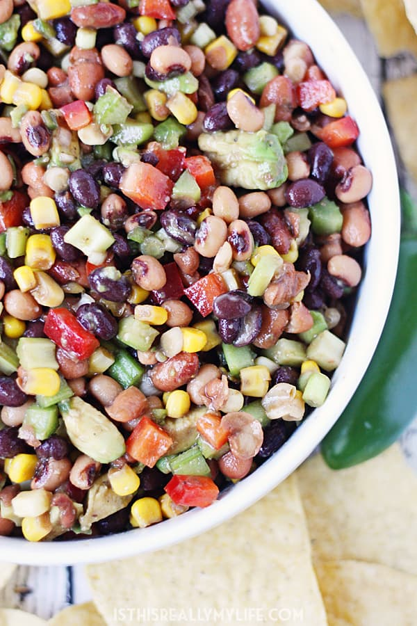 Cowboy Caviar - Cowboy caviar (a.k.a. cowboy salsa) is perfect for feeding a large crowd on Cinco de Mayo, Taco Tuesday or any day calling for amazing chips and salsa! | halfscratched.com