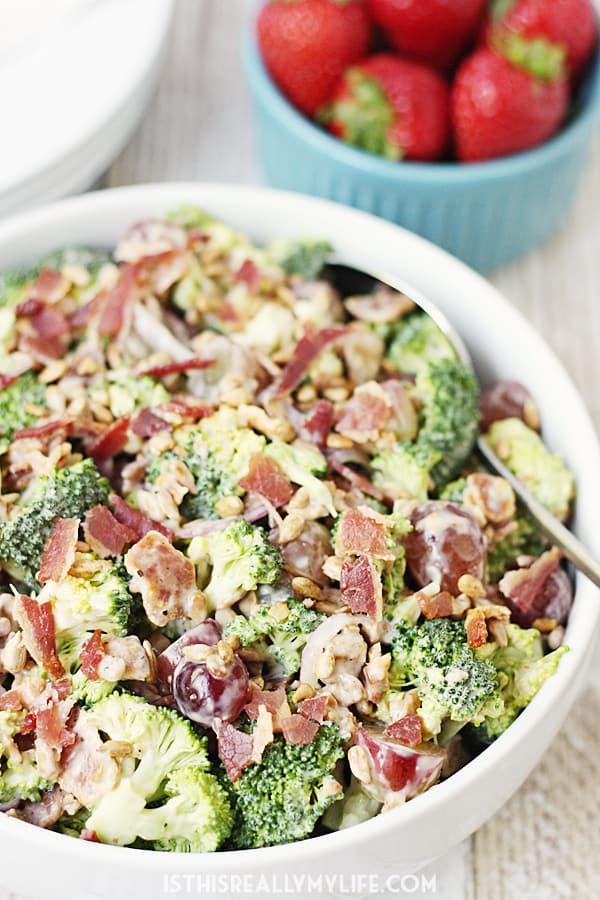 Creamy Bacon Broccoli Salad -- This creamy bacon broccoli salad is one of the best broccoli salads I've tasted. It features bacon, grapes, sunflower seeds and a creamy low-fat dressing.   halfscratched.com