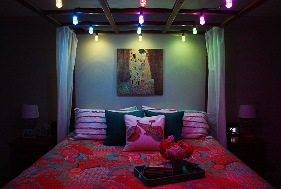 Simple Master Bedroom Makeover -- Edison-style cafe lights are the secret to creating the perfect (romantic) ambiance in this simple master bedroom makeover. | halfscratched.com
