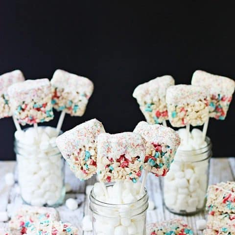 Krispie Treat Fireworks Pops -- Krispie treat fireworks pops are a fantastic last-minute 4th of July dessert—they're easy, irresistible and a total crowd pleaser!   isthisreallymyilfe.com