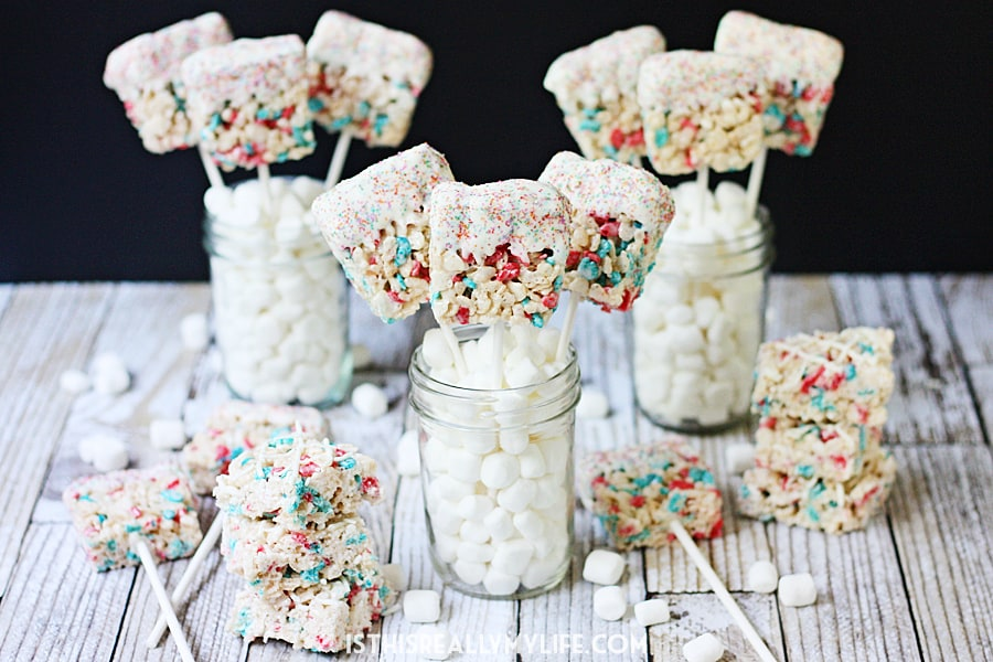 Krispie Treat Fireworks Pops -- Krispie treat fireworks pops are a fantastic last-minute 4th of July dessert—they're easy, irresistible and a total crowd pleaser! | isthisreallymyilfe.com