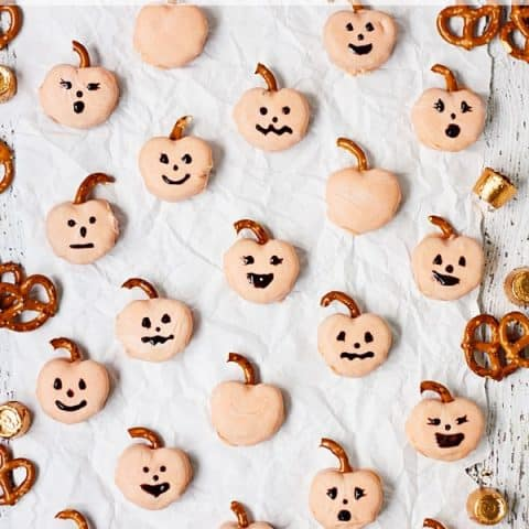 Candy-Coated Rolo Pretzel Pumpkins -- Rolo pretzels get a Halloween makeover! Candy-coated Rolo pretzel pumpkins require few ingredients and far less time than their carved counterparts! | halfscratched.com