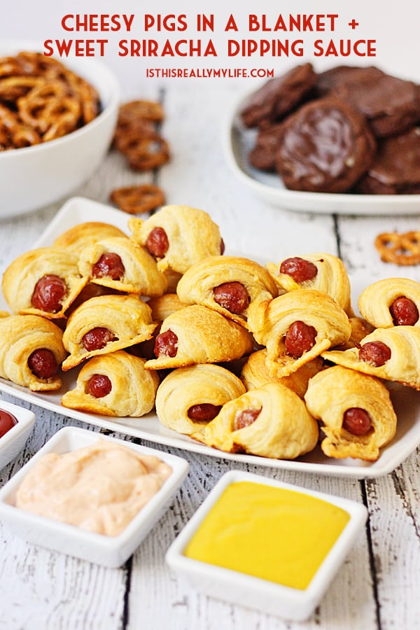 Cheesy Pigs in a Blanket + Sweet Sriracha Dipping Sauce -- After tasting these cheesy pigs in a blanket with sweet sriracha dipping sauce, you'll want to serve them at every game day party! | halfscratched.com