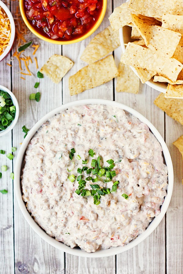 Spicy Sausage Dip -- This creamy, cheesy spicy sausage dip received rave reviews at a recent family party. It is the perfect appetizer for feeding a crowd during the holidays. | halfscratched.com
