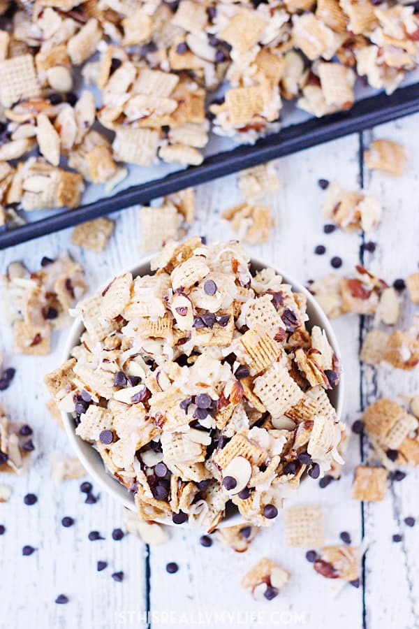 Coconut Almond Chex Mix with Grahams and Chocolate -- Coconut almond Chex mix becomes twice as irresistible after adding Golden Grahams and mini semisweet chocolate chips to the classic recipe.   halfscratched.com #recipe #chexmix