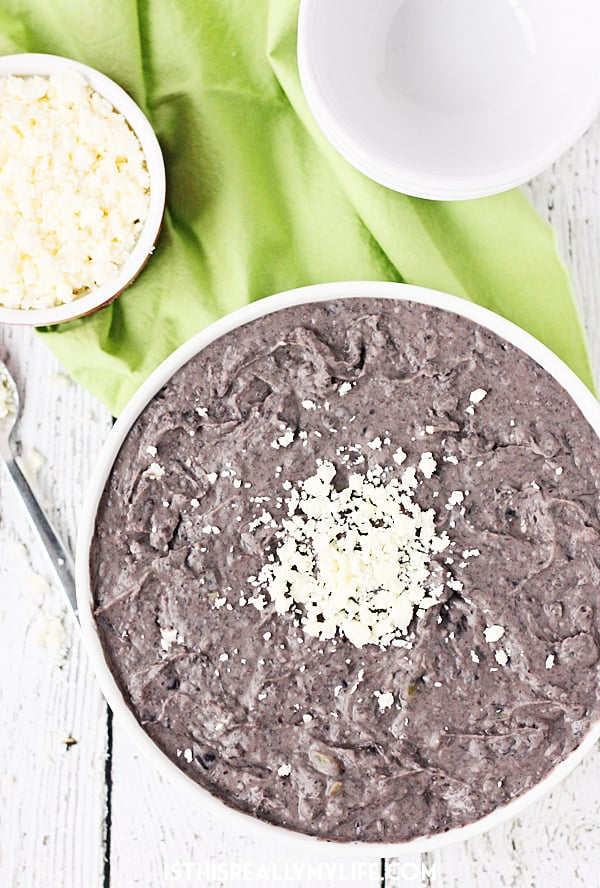 Slow Cooker Refried Black Beans -- These slow cooker refried black beans are so good, you'll want to make them every Taco Tuesday. Good thing they're easy and require only a handful of ingredients!   halfscratched.com #slowcooker #crockpot #mexican