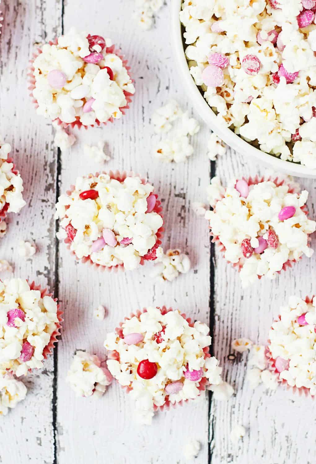 3-Ingredient Valentine's Popcorn Balls -- Valentine's popcorn balls are a super fun treat to serve at your Valentine's parties. With only three ingredients, they're super quick and easy to make! | halfscratched.com #valentinesday #recipe #popcorn