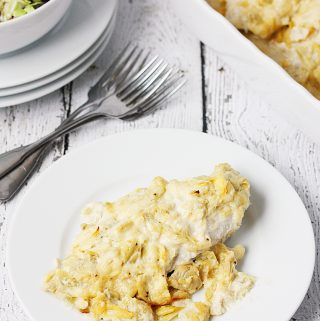 Artichoke Chicken Bake -- This artichoke chicken bake has only five ingredients, including the chicken breasts, and tastes like baked chicken smothered with hot artichoke dip. It's divine.   halfscratched #recipe #chicken