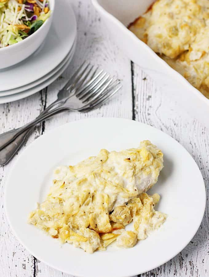 Artichoke Chicken Bake -- This artichoke chicken bake has only five ingredients, including the chicken breasts, and tastes like baked chicken smothered with hot artichoke dip. It's divine. | halfscratched #recipe #chicken