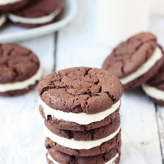 Cake Mix Oreo Cookies -- Cake mix Oreo cookies are a soft, chewy, delicious alternative to the store-bought variety. Devil's food cake mix makes them extra fudgy and an easy cream cheese frosting seals this sandwich deal! | halfscratched.com #cookie #recipe #dessert