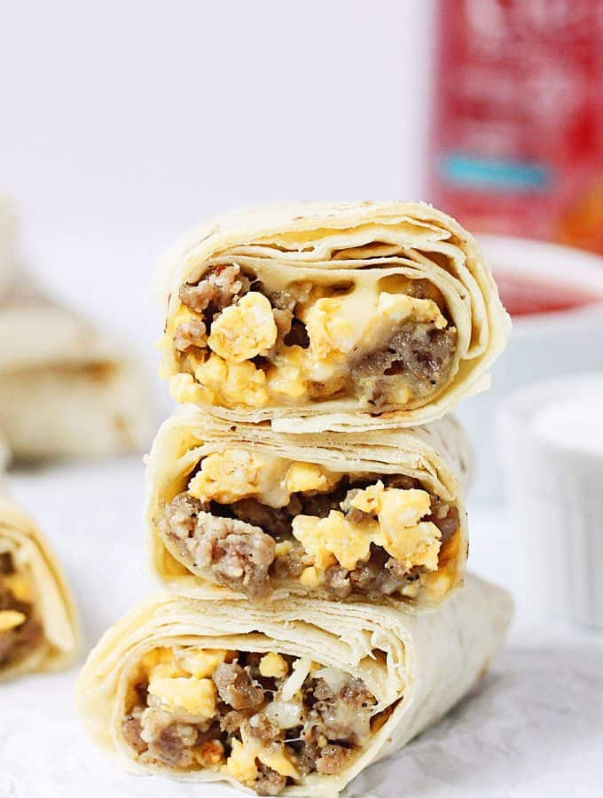 Make-Ahead Freezer Breakfast Burritos -- These make-ahead freezer breakfast burritos are kid tested and approved! Less than 20 minutes to prep and less than 3 minutes to reheat. Nothing like a yummy, quick, on-the-go breakfast! | halfscratched.com #recipe #breakfast
