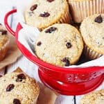Oatmeal Raisin Cake Mix Muffins -- Bake a batch of these oatmeal raisin cake mix muffins and see if your family doesn't eat them in record time. Don't like raisins? Try mini chocolate chips or craisins instead! | halfscratched.com #recipe #breakfast